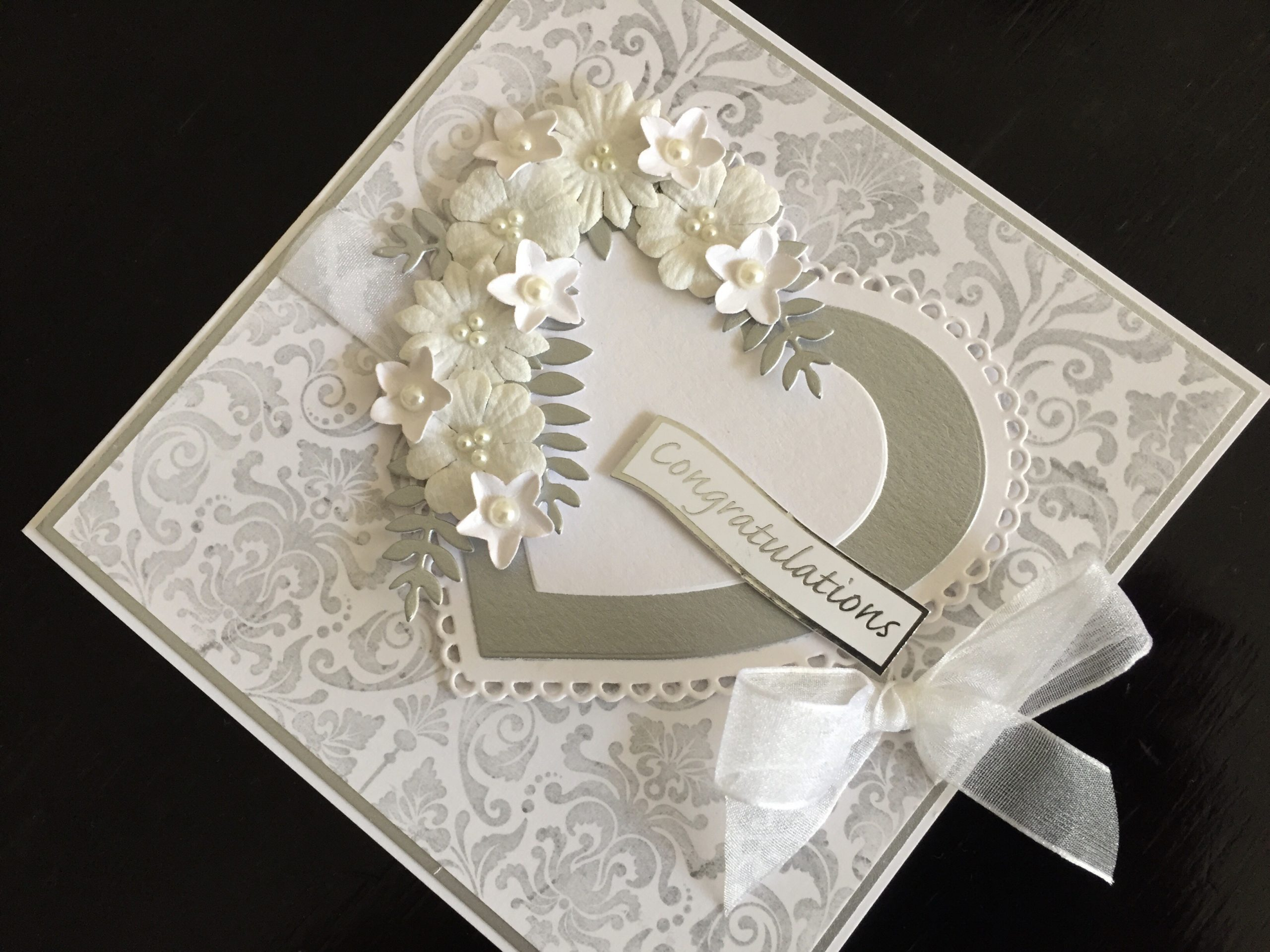 Silver and white wedding card with hearts and flowers