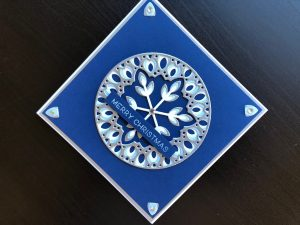 Hand made Christmas card with Issa Snowflake layering die in blue and silver