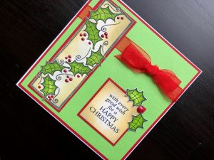 Christmas card using the holly panel clear stamp set with Nuvo drops and ribbon