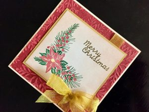 Hand Made Christmas Card with Embossed Background and Layered Poinsettia Stamp