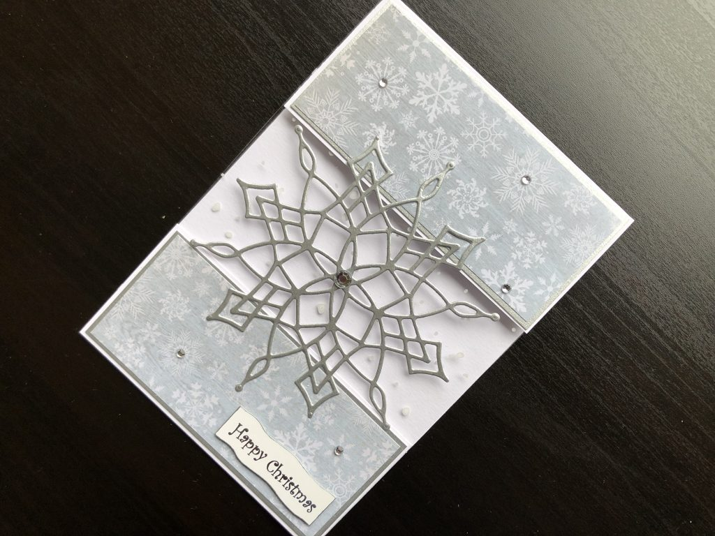 Hand made Christmas card with a die cut silver snowflake