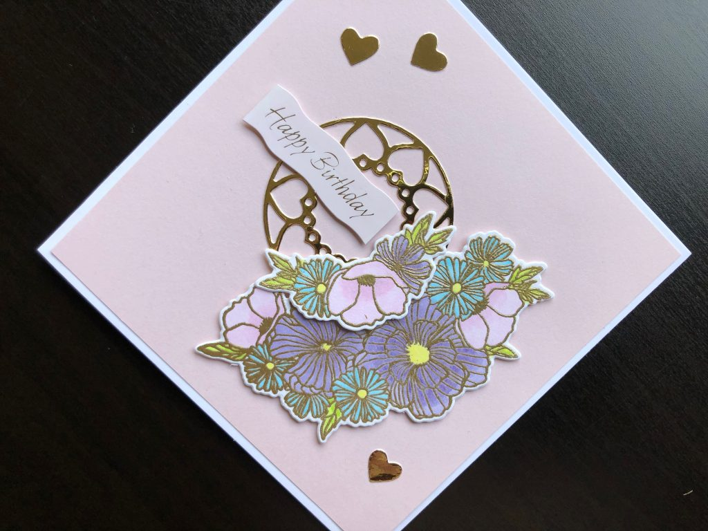 Hand made birthday card with stamped and die cut pastel flowers