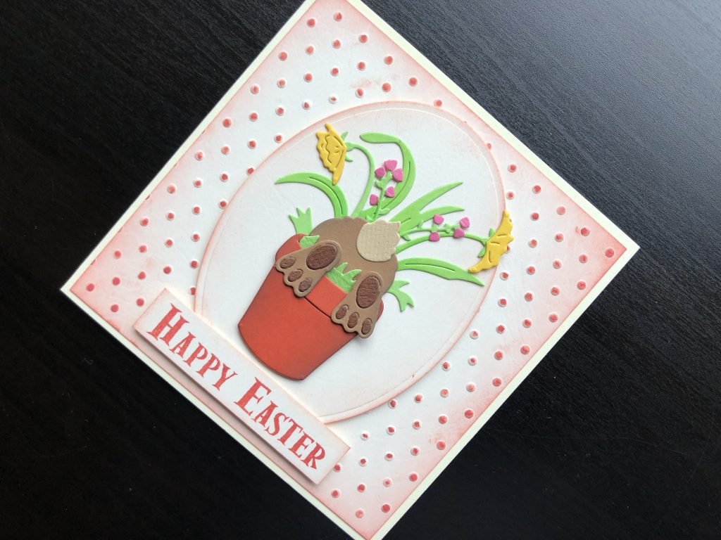 Hand made Easter card with a bunny rabbit in a flower pot.