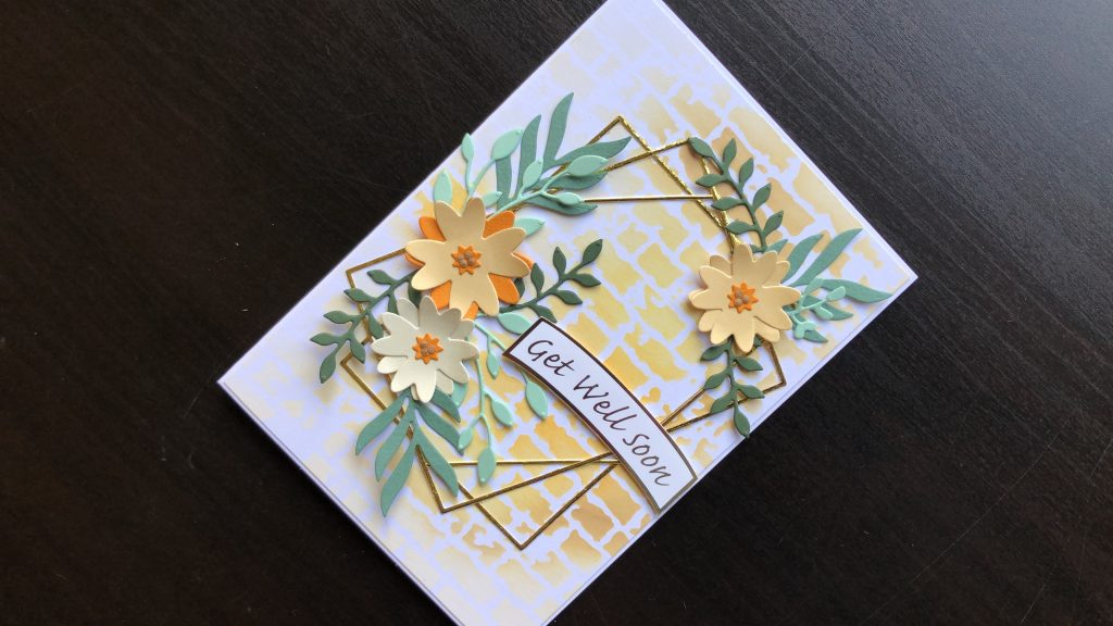 Hand made get well card with die cut flowers and frame with an inked background.