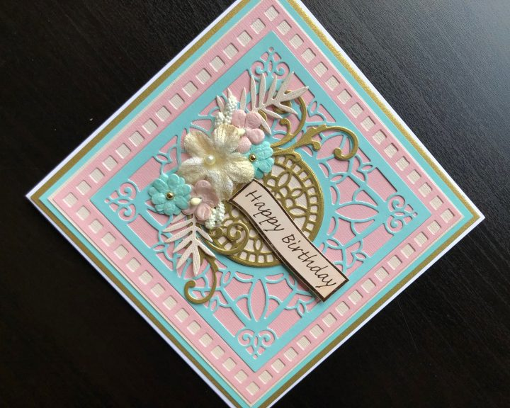 hand made birthday card with die cutting and flowers