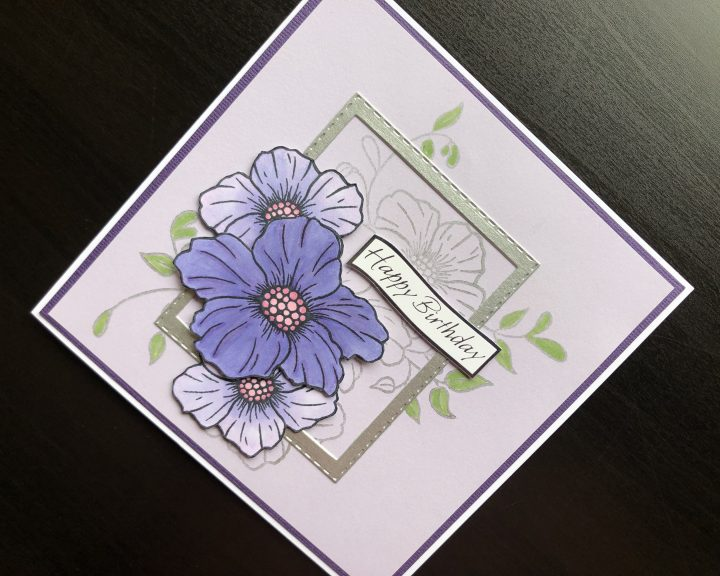 Hand made birthday card with stamped flowers and die cut frame