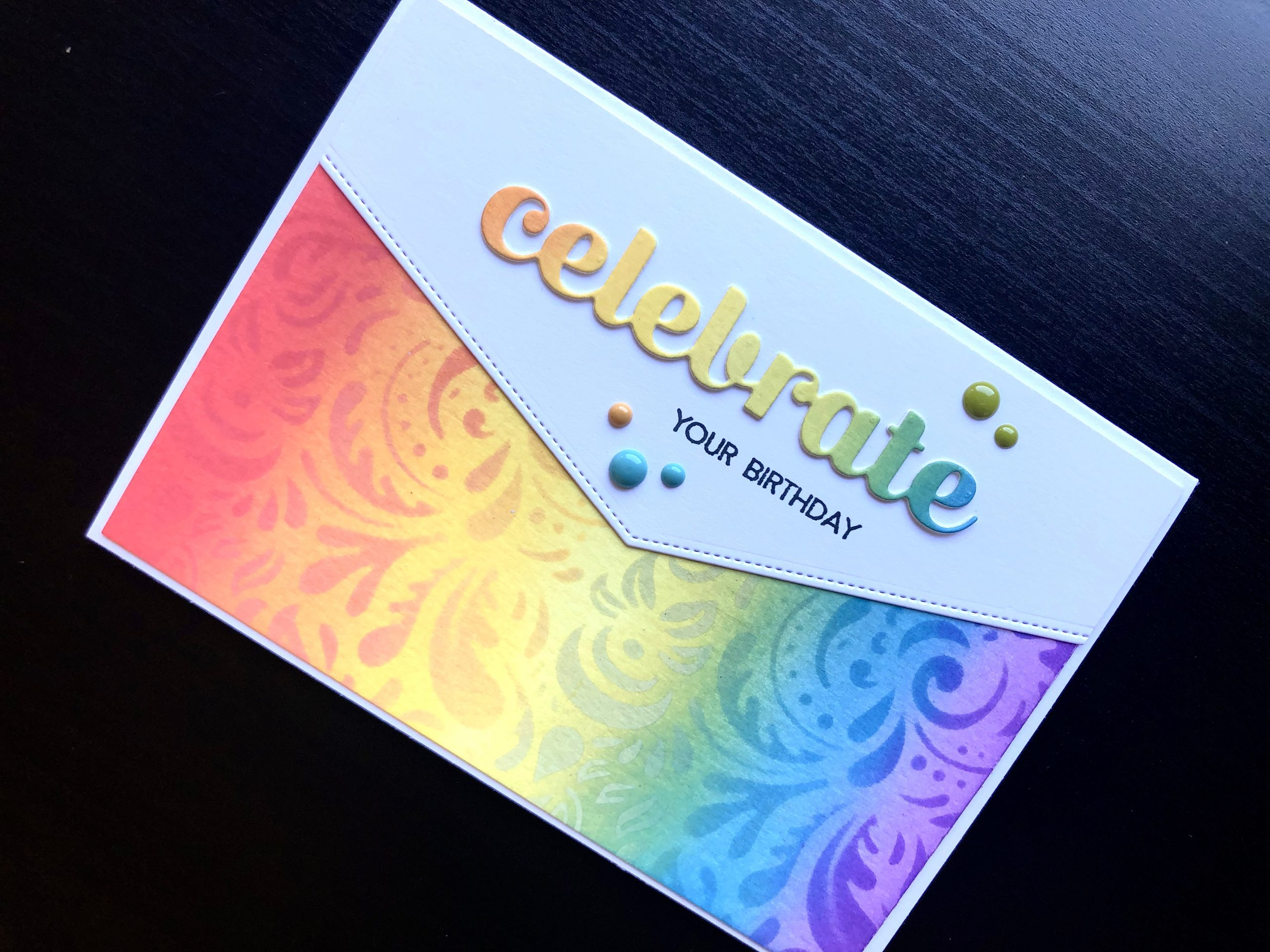 hand made birthday card with inked rainbow and die cut celebrate