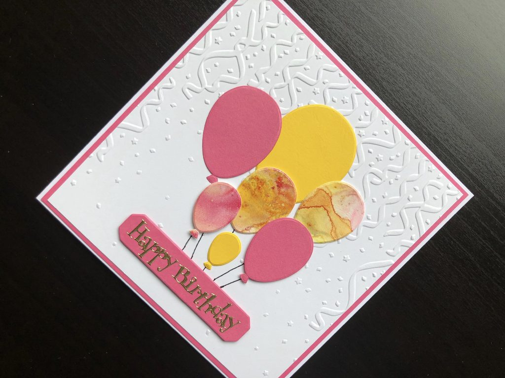 Hand made birthday card with embossed background and die cut balloons.