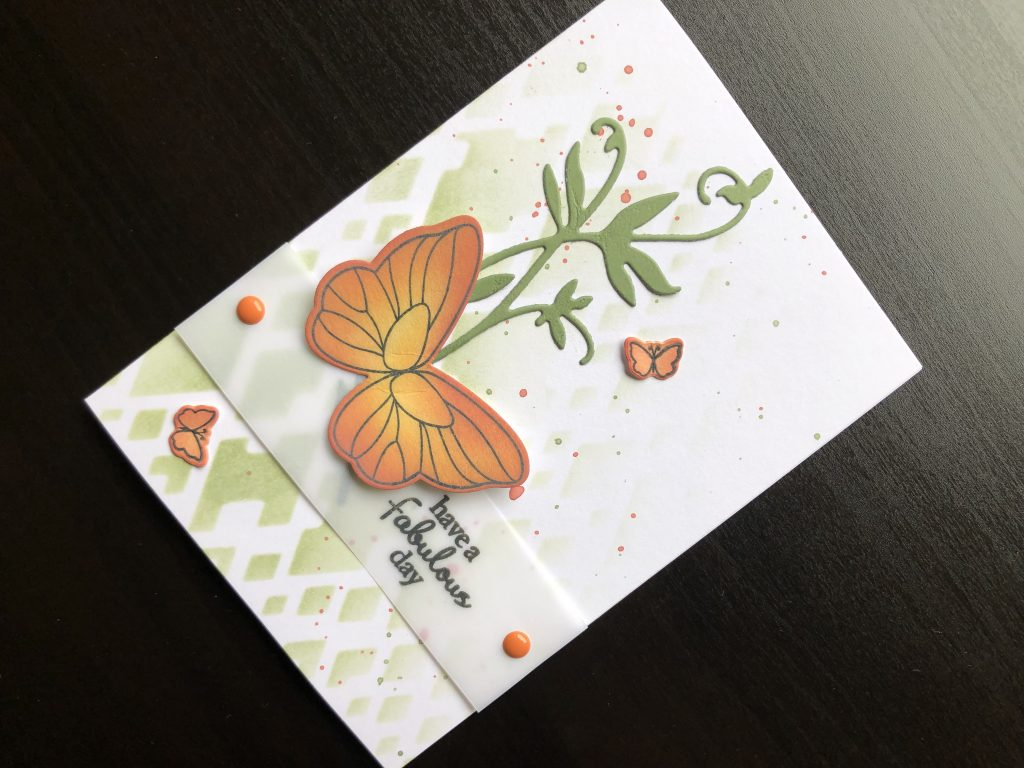 Hand made birthday card with die cut butterfly and stencilled background.