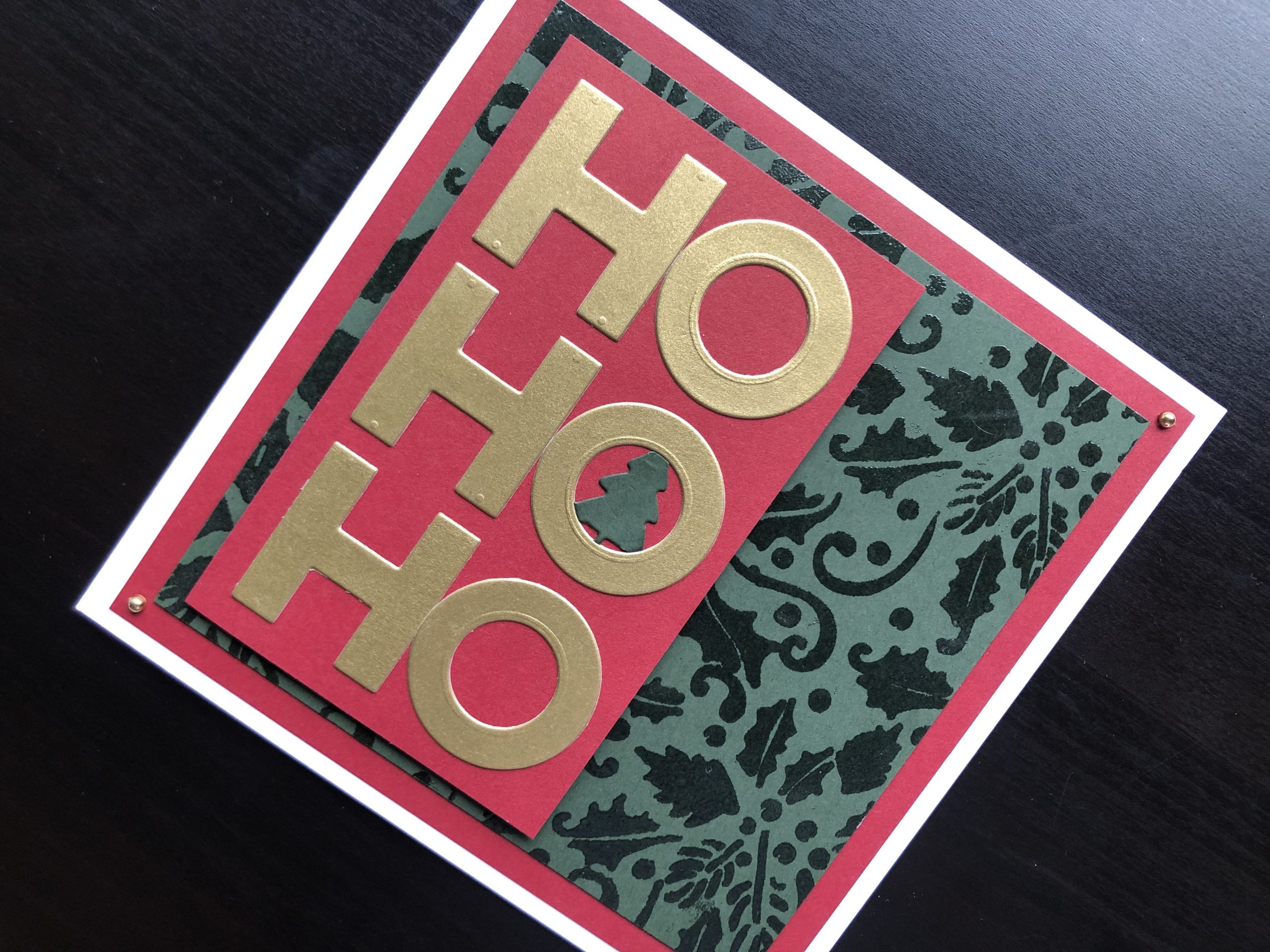 Hand made christmas card with stencilled background and die cut Ho Ho Ho