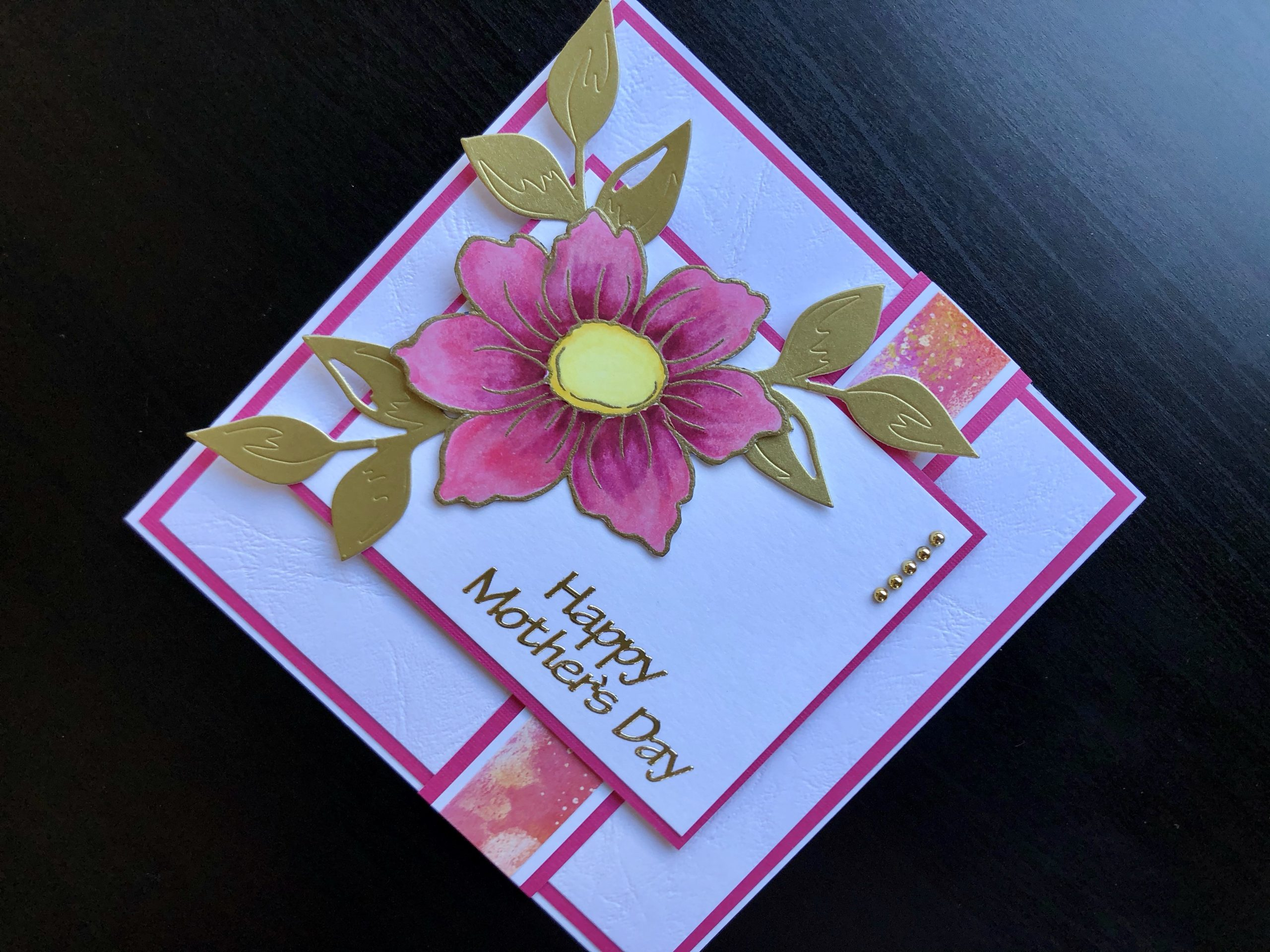 Hand made Mothers Day card with pink stamped dog rose and gold leaves
