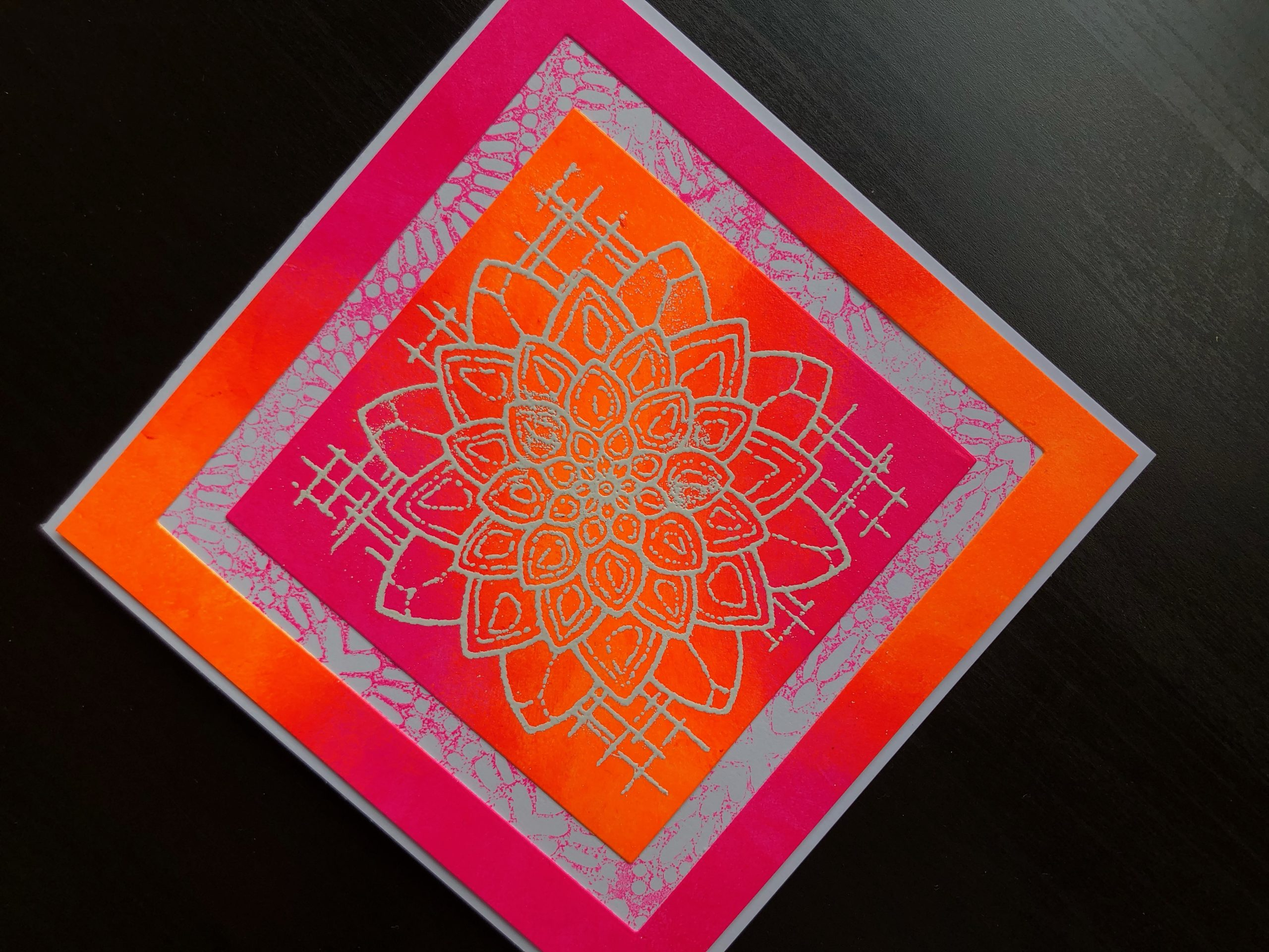 Hand made card with Neon Polish and stamped, heat embossed Blossom