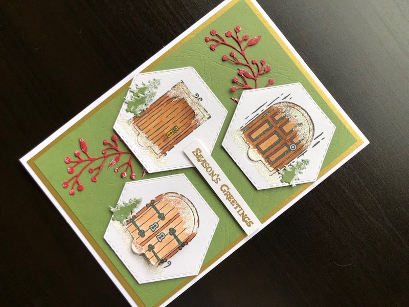 Hand made Christmas card with stamped and die cut fairy doors
