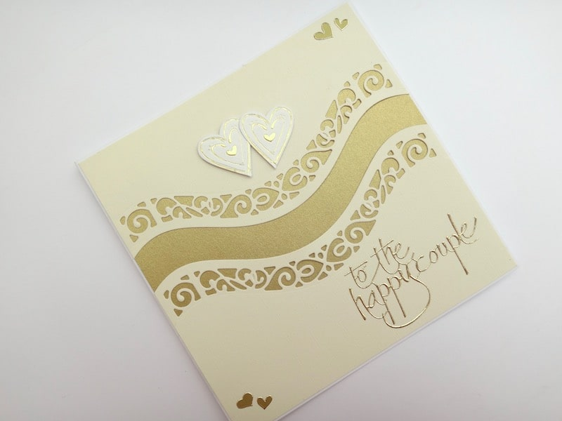 Wedding card with double die cut curved border and insert