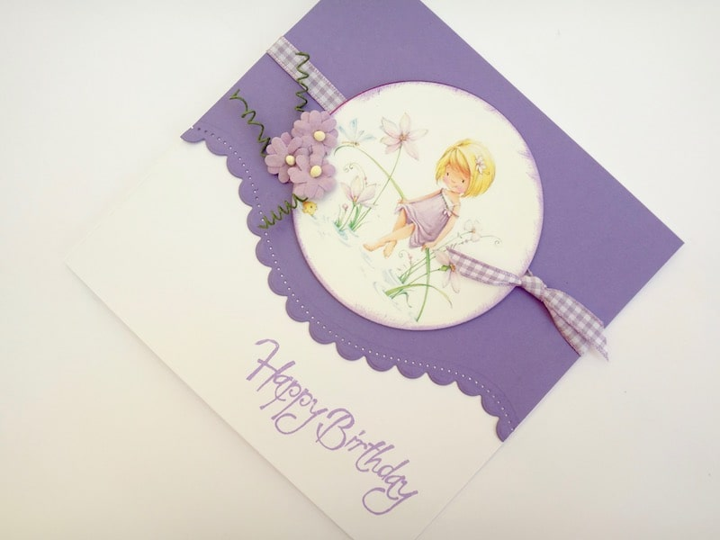 Birthday card with curved border die cut edge and flower girl card topper.