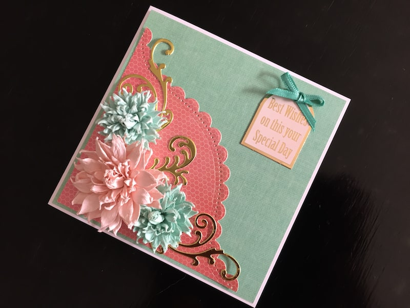 Birthday card with curved border die cut and paper flowers