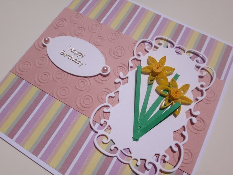 Hand made birthday card with quilled daffodils and die cut tag