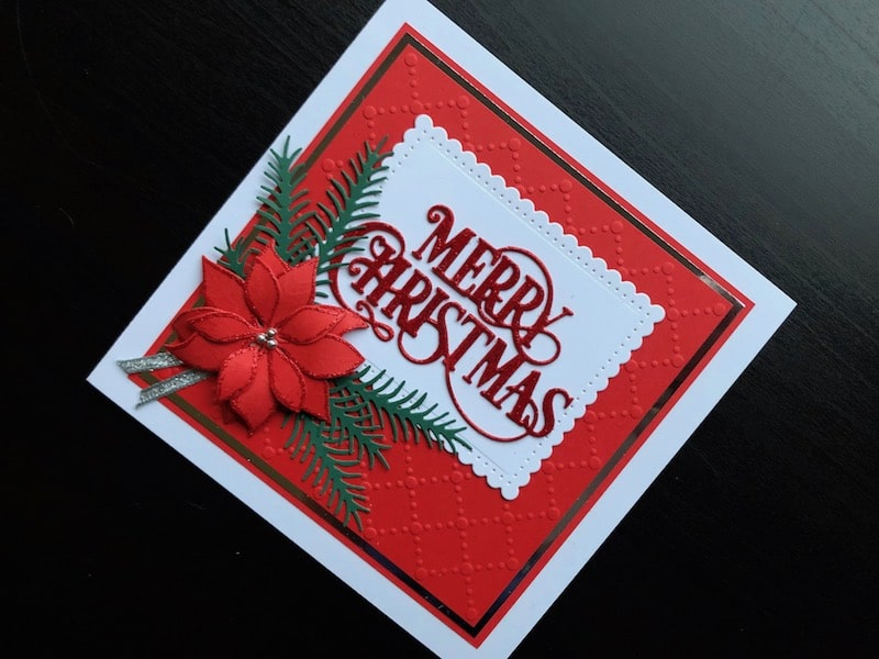 Die cut Merry Christmas card with poinsettia