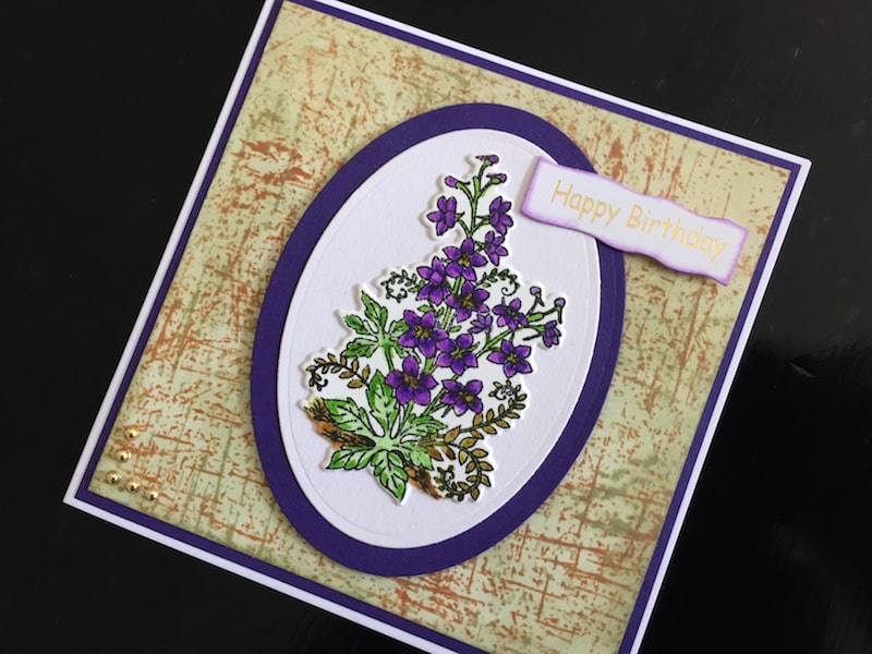 Hand made birthday card with stamped and die cut larkspur flowers