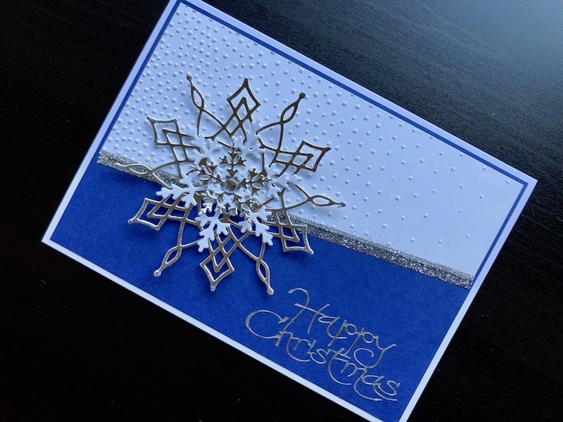 Christmas card with embossed background and die cut snowflakes
