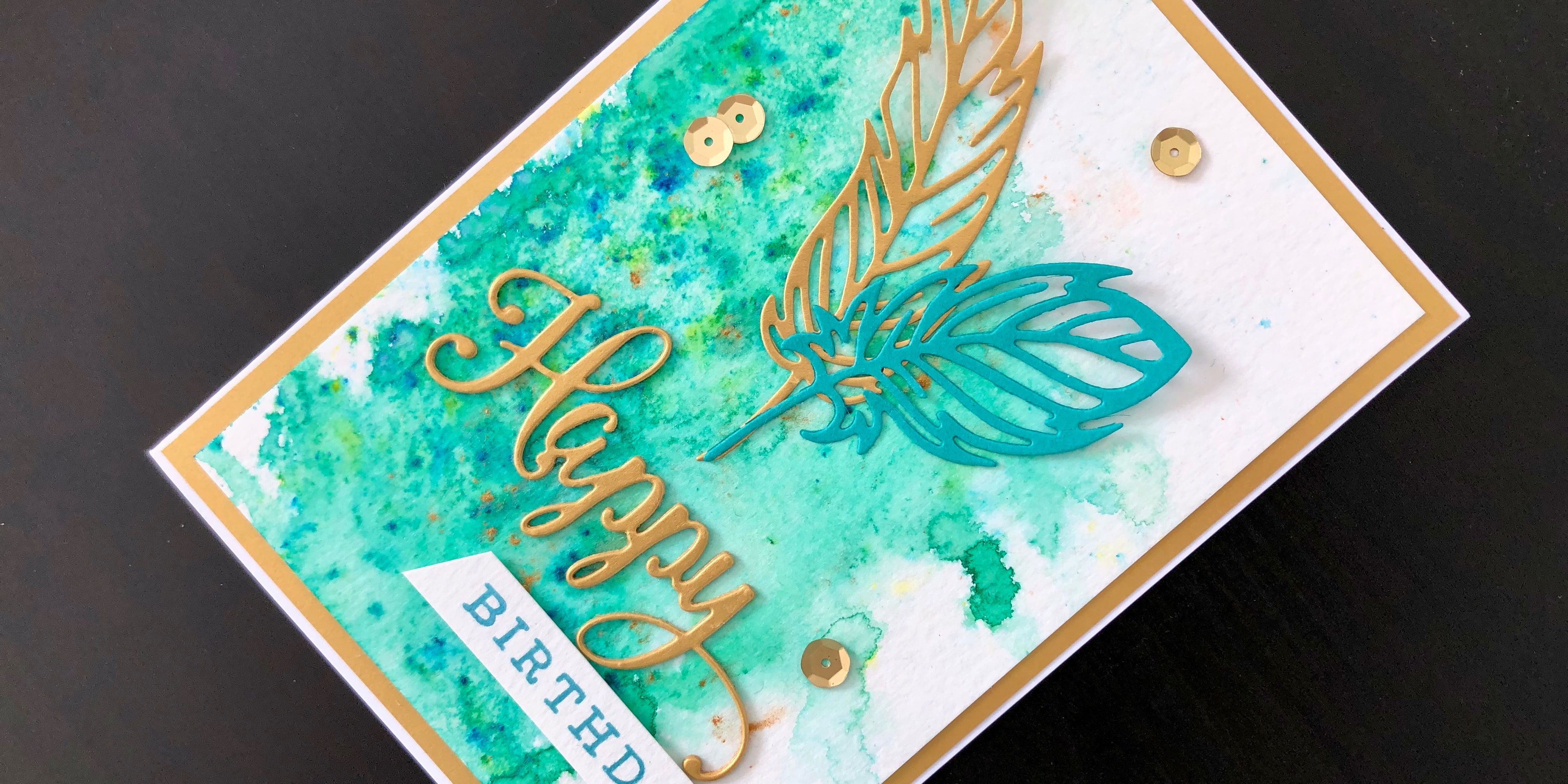 hand made birthday card with pixie powder background and die cut feathers