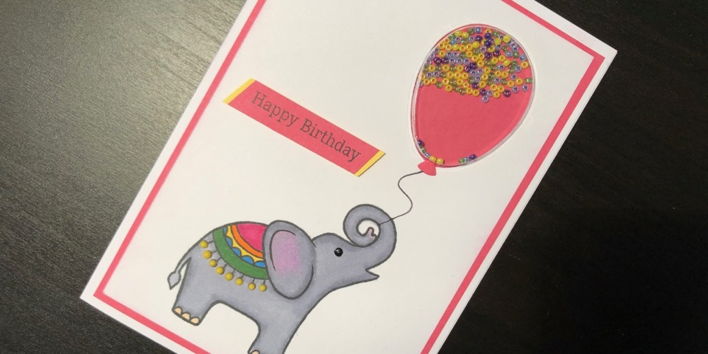 Hand made Birthday card with stamped elephant and balloon shaped shaker